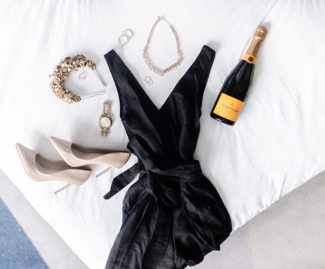 Dress and heals flatlay on the bed at Crowne Plaza Melbourne for Spring Racing