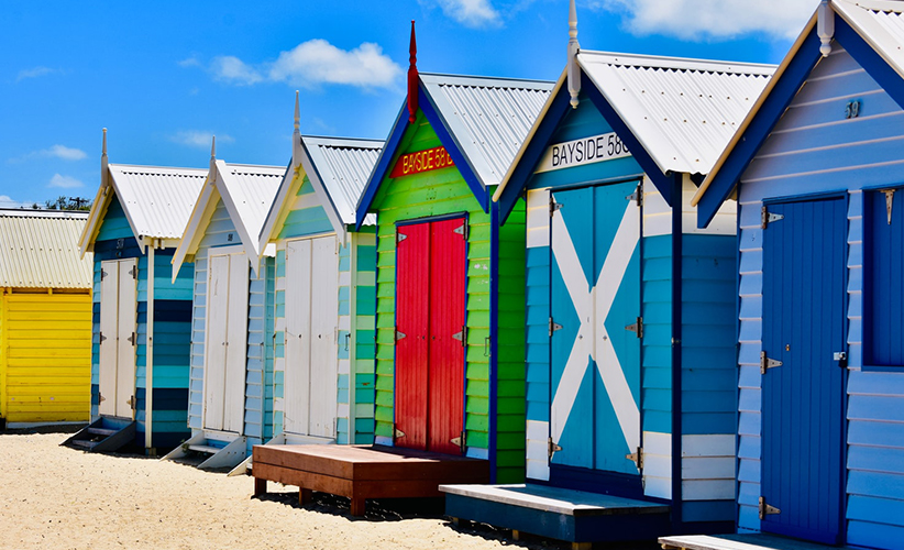Small beach houses in different colours